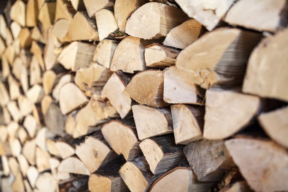 Firewood stack of chopped wood background